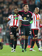 Jermain Defoe (l) and Vito Mannone of Sunderland celebrate after the Barclays Premier League match at the Stadium Of Light, Sunderland<br /> Picture by Simon Moore/Focus Images Ltd 07807 671782<br /> 11/05/2016