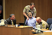 April 1, 2014 - El Cajon, California, U.S - <br /> <br /> Iraqi Immigrant Guilty In Wife's Murder<br /> <br /> 2014_Murder suspect Kassim Alhimidi reacts to being found guilty for the murder of his wife Shaima Alawadi. As the verdict was read the victim's mother and the defendant's son yelled in court and he was dragged from court. Defense attorney Richard Berkon sits at left.<br /> ©Exclusivepix