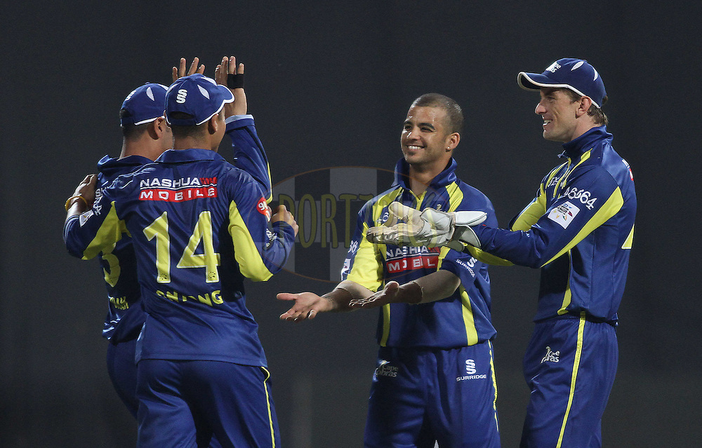 Cape Cobras celebrate a wicket during match 11 of the NOKIA Champions League T20 ( CLT20 ) between the Mumbai Indians and The Cape Cobras held at the  M.Chinnaswamy Stadium in Bangalore , Karnataka, India on the 30th September 2011..Photo by Shaun Roy/BCCI/SPORTZPICS