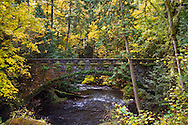 The Sandstone Bridge at Whatcom Falls and spanning Whatcom Creek was built in 1930 from Chuckanut sandstone as part of the Roosevelt administrations Works Progress Administration program.