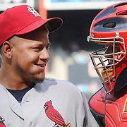 NEW YORK, NEW YORK - July 26: Pitcher Carlos Martinez #18 of the St. Louis Cardinals with catcher Yadier Molina #4 of the St. Louis Cardinals after getting out of the first inning during the St. Louis Cardinals Vs New York Mets regular season MLB game at Citi Field on July 26, 2016 in New York City. (Photo by Tim Clayton/Corbis via Getty Images)