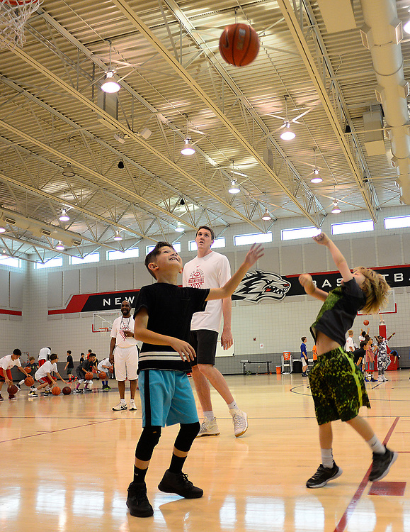 apl0604517b/SPORTS/pierre-louis/JOURNAL 060517<br /> Former UNM Lobo player Joe Furstinger,, watches as 9 year-old Colton Chavez,, left defends a shot by 8 year-old Luke Patterson ,, during the UNM Basketball Camp for Kids  .Photographed  on Monday June  5,  2017. .Adolphe Pierre-Louis/JOURNAL