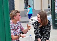 Young people enjoy some time together near Teatralnaya Ploschad in St. Petersburg, Russia.