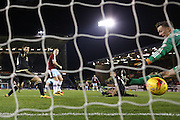 Burnley forward Sam Vokes scores past Nottingham Forest goalkeeper Dorus de Vries  during the Sky Bet Championship match between Burnley and Nottingham Forest at Turf Moor, Burnley, England on 23 February 2016. Photo by Simon Davies.