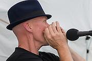 Owen McAlpine performing at the music festival; the Long Cram Jam