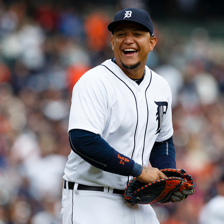 Apr 6, 2015; Detroit, MI, USA; Detroit Tigers first baseman Miguel Cabrera (24) smiles towards the Minnesota Twins dugout as he walks out to start the ninth inning at Comerica Park. Detroit won 4-0. Mandatory Credit: Rick Osentoski-USA TODAY Sports