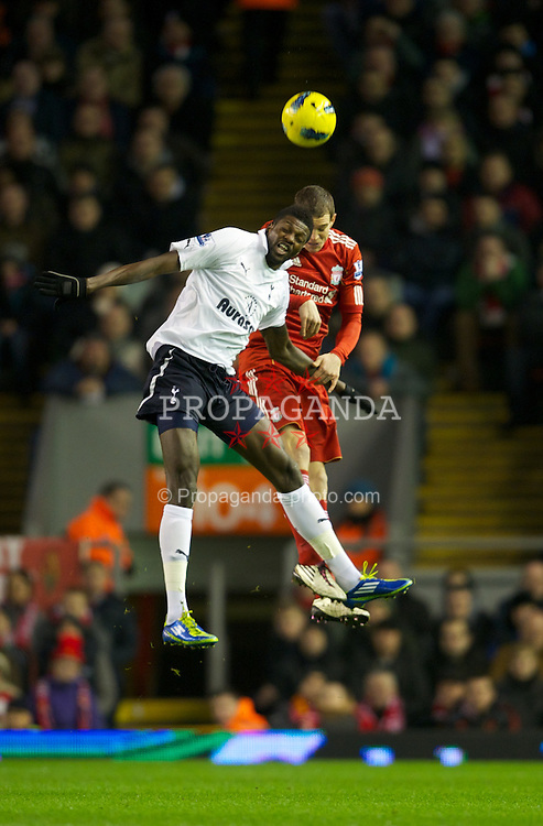 LIVERPOOL, ENGLAND - Monday, February 6, 2012: Liverpool's Daniel Agger in action against Tottenham Hotspur's Emmanuel Adebayor during the Premiership match at Anfield. (Pic by David Rawcliffe/Propaganda)