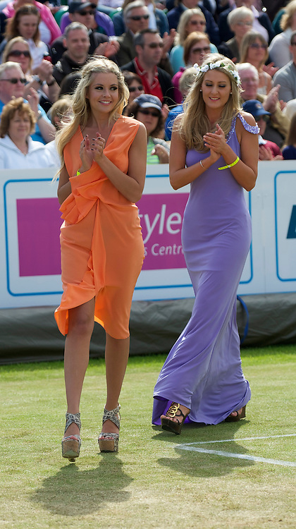 LIVERPOOL, ENGLAND - Saturday, June 19, 2010: A model on centre court during a fashion parade on day four of the Liverpool International Tennis Tournament at Calderstones Park. (Pic by David Rawcliffe/Propaganda)