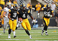 September 17, 2011: Iowa Hawkeyes kick returner Jordan Bernstine (4) looks for running room during the first half of the game between the Iowa Hawkeyes and the Pittsburgh Panthers at Kinnick Stadium in Iowa City, Iowa on Saturday, September 17, 2011. Iowa defeated Pittsburgh 31-27.