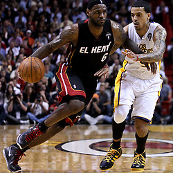 March 10, 2011; Miami, FL, USA; Miami Heat small forward LeBron James (6) drives past Los Angeles Lakers small forward Matt Barnes (9) during the third quarter at the American Airlines Arena. The Heat defeated the Lakers 94-88.   Mandatory Credit: Derick E. Hingle
