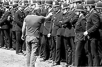 A striking miner points at a policeman at Orgreave during the 1984-85 miners strike.