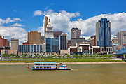 View of the Cincinnati skyline with a riverboat on the Ohio River