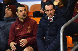 Arsenal manager Unai Emery (right) in the stands during the Emirates FA Cup, third round match at Bloomfield Road, Blackpool.
