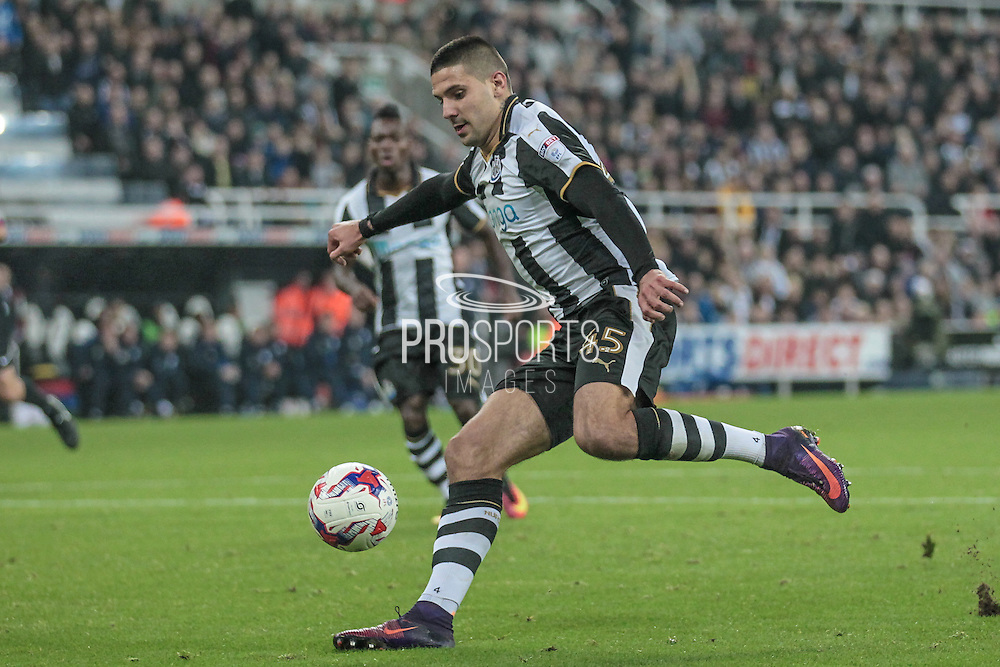 Aleksandar Mitrović (Newcastle United) cuts inside two Preston defenders to score Newcastle's fourth goal of the game during the EFL Cup 4th round match between Newcastle United and Preston North End at St. James's Park, Newcastle, England on 25 October 2016. Photo by Mark P Doherty.