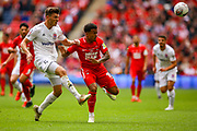 AFC Flyde defender Jordan Tunnicliffe (5) tussles with Leyton Orient forward Josh Koroma (19) during the FA Trophy final match between AFC Flyde and Leyton Orient at Wembley Stadium on 19 May 2019.