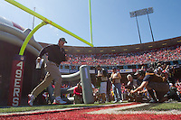 18 September 2011: Head coach Jim Harbaugh of the San Francisco 49ers runs onto the field before the Dallas Cowboys 27-24 overtime victory against the 49ers in an NFL football game at Candlestick Park in San Francisco, CA