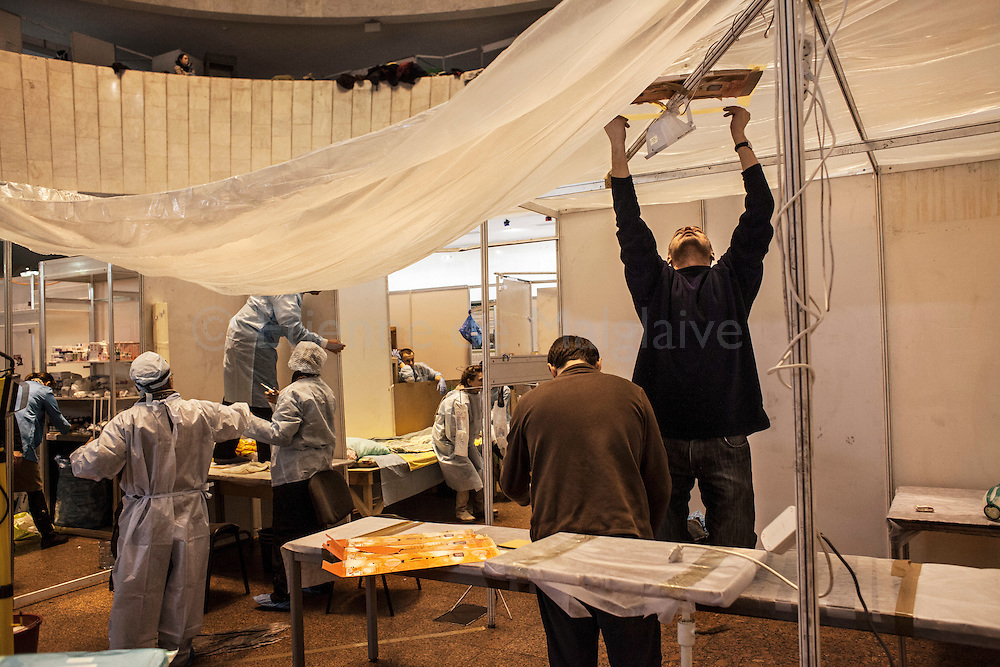 A medical team set up a surgical operation room at a field hospital in the Ukraine House near Maidan Square on February 20, 2014 in Kiev, Ukraine. Violent clashes intensified for a second day as Ukranian security forces fired live ammunition and at least 70 people died in the fighting, according to published reports quoting medical workers who were treating the victims.