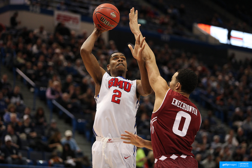 Yanick Moreira, (left), SMU, shoots over Obi Enechionyia, Temple, during the Temple Vs SMU Semi Final game at the American Athletic Conference Men's College Basketball Championships 2015 at the XL Center, Hartford, Connecticut, USA. 14th March 2015. Photo Tim Clayton