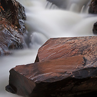 Long exposure of an overflow tributary on the Potomac River, just above the Great Falls, Great Falls National Park, Great Falls, Virginia