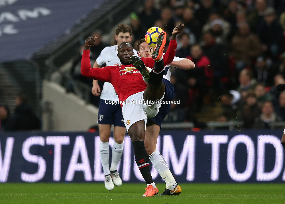 31st January 2018, Wembley Stadium, London England; EPL Premier League football, Tottenham Hotspur versus Manchester United; Romelu Lukaku of Manchester United and Toby Alderweireld of Tottenham Hotspur compete for the ball