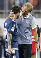 HOUSTON, TEXAS - JUNE 21: United States head coach hugs Lionel Messi #10 of Argentina  after the Semifinal match between Argentina and US at NRG Stadium as part of Copa America Centenario US 2016 on June 21, 2016 in Houston, Texas, US. Argentina won 4 to 0. (Photo by Thomas B. Shea/LatinContent/Getty Images)