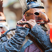 Costumed musicians in a parade playing traditional Carnival (Fastnacht) music in Basel, Switzerland.