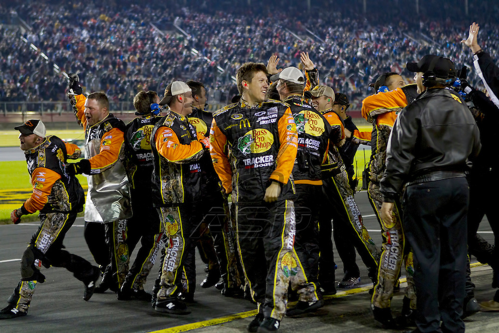 CONCORD, NC - OCT 16, 2010:  Jamie McMurray's team celebrates on pit road after winning the Bank of America 500 race at the Charlotte Motor Speedway in Concord, NC.