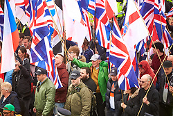 © Licensed to London News Pictures. 01/04/2017. LONDON, UK.  EDL and Britain First protest march through central London. The Met police imposed conditions on the protest and a counter protest in the expectation of serious disorder.  In this picture: Britain First protesters.     Photo credit: Cliff Hide/LNP
