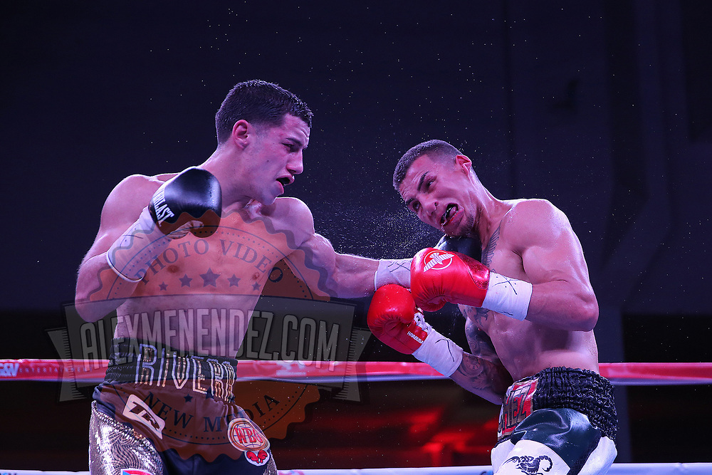 "Jean Carlos ""Chapito"" Rivera punches Jason Sanchez during their championship boxing match for the WBO Junior World Title at the Hotel El Panama Convention Center on Wednesday, October 31, 2018 in Panama City, Panama. (Alex Menendez via AP)"