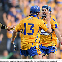 28 September 2013; Shane O'Donnell, Clare, celebrates after scoring his side's second goal with team-mate Podge Collins, 13. GAA Hurling All-Ireland Senior Championship Final Replay, Cork v Clare, Croke Park, Dublin. Picture credit: Stephen McCarthy / SPORTSFILE