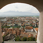 View from tower window in Castle or Schloss Thun of the city of Thun, Switzerland, the Alps and the River Aare<br />