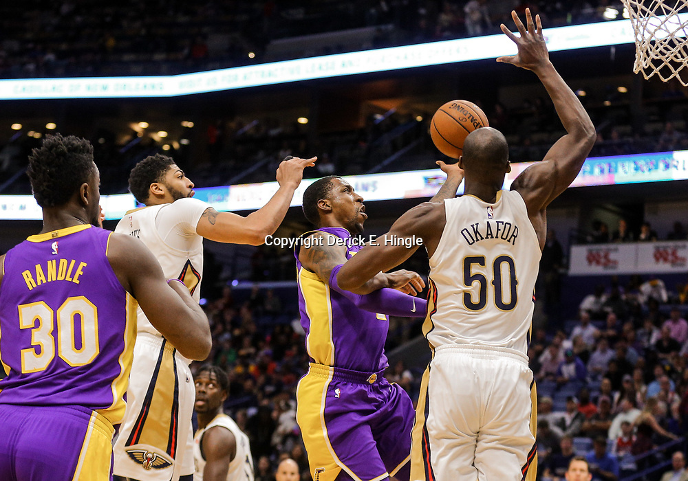 Mar 22, 2018; New Orleans, LA, USA; Los Angeles Lakers guard Kentavious Caldwell-Pope (1) shoots over New Orleans Pelicans center Emeka Okafor (50) and forward Anthony Davis (23) during the first quarter at the Smoothie King Center. Mandatory Credit: Derick E. Hingle-USA TODAY Sports