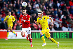 Gavin Reilly of Bristol Rovers takes on Daniel Pinillos of Barnsley - Mandatory by-line: Robbie Stephenson/JMP - 27/10/2018 - FOOTBALL - Oakwell Stadium - Barnsley, England - Barnsley v Bristol Rovers - Sky Bet League One