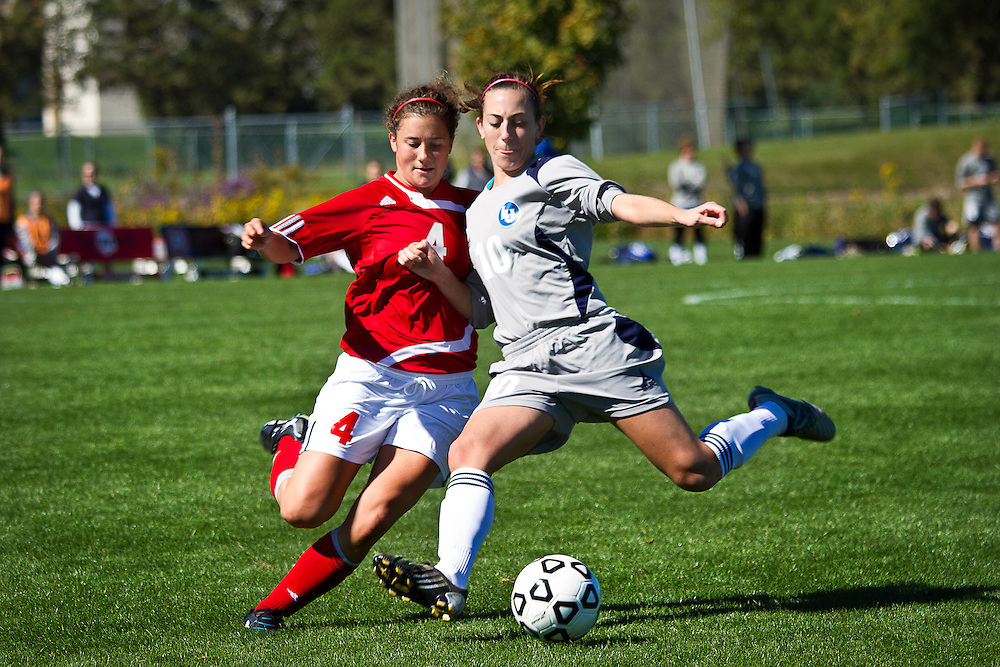 Mary Ulseth '13, left, leans in for a tackle against Lawrence Forward Mallory Koula '12 during the Pioneers' 1-3 loss on Sunday at Springer field.