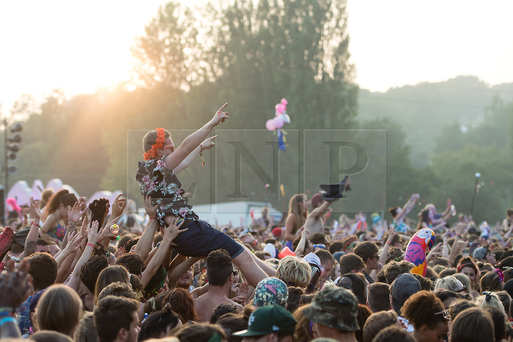 © Licensed to London News Pictures. 07/09/2014. Isle of Wight, UK. Bestival 2014 festival goers attempting to crowd surf as they watch Major Lazer perform on the main stage of Bestival 2014 Day 4 Sunday the final day of the festival. This weekend's headliners include Chic featuring Nile Rodgers, Foals and Outcast.   Bestival is a four-day music festival held at the Robin Hill country park on the Isle of Wight, England. It has been held annually in late summer since 2004.    Photo credit : Richard Isaac/LNP