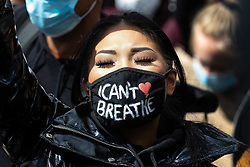 """© Licensed to London News Pictures. 06/06/2020. Manchester, UK. A woman wearing an """" I can't breathe """" mask . Tens of thousands attend a Black Lives Matter demonstration against police violence , centred in Piccadilly Gardens in Manchester City Centre . Protests have and are being held around the world , after George Floyd was killed whilst being restrained by police in Minneapolis on 25th May 2020 . Photo credit: Joel Goodman/LNP"""
