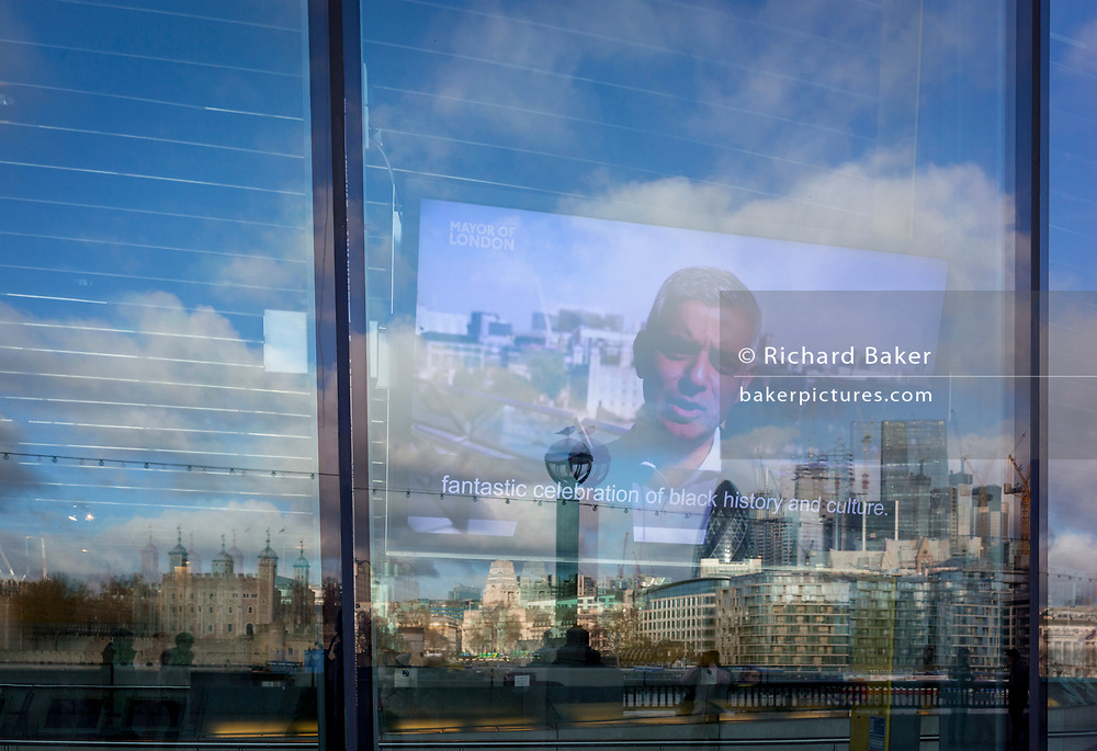 With the City skyline in the distance, the Mayor of London Sadiq Khan speaks to Londoners from a screen inside City Hall on the Southbank, on 14th December 2017, in London, England.