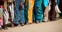 Hoards of pilgrims wait in lines at the Kumbh Mela to pray to Krishna.