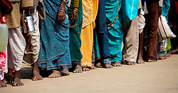 Hoards of pilgrims wait in lines at the Kumbh Mela to pray to Krishna.