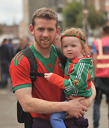 Stevie Gavin from Castlebar with his daughter Katie on their way to the All Ireland Semi-final between Mayo and Dublin on sunday last.<br /> Pic Conor McKeown