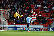 Doncaster Rovers N0 38 Craig Alcock Heades Towards Goal Only To Be Saved By Covetrys Goal Keeper Reice Charles-Alcock during the Sky Bet League 1 match between Doncaster Rovers and Coventry City at the Keepmoat Stadium, Doncaster, England on 23 April 2016. Photo by Stephen Connor.