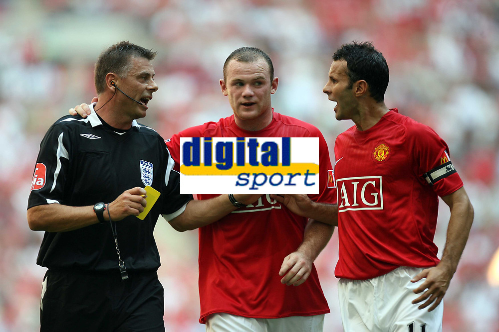Photo: Rich Eaton.<br /> <br /> Manchester United v Chelsea. FA Community Shield. 05/08/2007. Man United's skipper Ryan Giggs (r) discusses Wayne Rooneys (c) yellow card with referee Mark Halsey