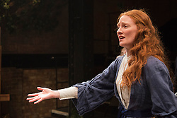 """© Licensed to London News Pictures. 21/11/2013. London, England. Pictured: Emma West as Lizzie Siddal. World premiere of the play """"Lizzie Siddal"""" at the Arcola Theatre, Hackney, London. The play tells the story of the woman who was 'Ophelia' in Millais' famous painting. Running from 20 November to 21 December 2013. With Emma West as Lizzie Siddal and Tom Bateman as Dante Gabriel Rossetti. Photo credit: Bettina Strenske/LNP"""