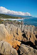 pancake rocks at punakaiki in the foreground with distant views of paparoa national park along the west coast of new zealand