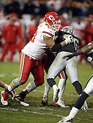 Kansas City Chiefs tackle Ryan Harris (68) blocks Oakland Raiders middle linebacker Miles Burris (56) during the NFL week 12 regular season football game against the Oakland Raiders on Thursday, Nov. 20, 2014 in Oakland, Calif. The Raiders won their first game of the season 24-20. ©Paul Anthony Spinelli