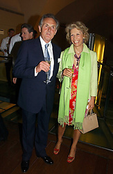 LORD & LADY HINDLIP at the opening reception of 'Bejewelled by Tiffany 1837-1987' at The Gilbert Collection, Somerset House, London on 21st June 2006.