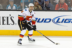 Feb 8, 2012; San Jose, CA, USA; Calgary Flames defenseman Mark Giordano (5) skates with the puck against the San Jose Sharks during the first period at HP Pavilion. Calgary defeated San Jose 4-3. Mandatory Credit: Jason O. Watson-US PRESSWIRE
