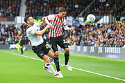 Derby County forward David Nugent (28) clashes with Brentford defender Henrik Dalsgaard (22) during the EFL Sky Bet Championship match between Derby County and Brentford at the Pride Park, Derby, England on 22 September 2018.