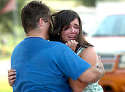 Tommy Kirk comforts his daughter Jamie as they watch their home in Lindale burn during a fire that required the fire fighting resources of the departments of Lindale, Mineola and Dixie to get under control. Photo: Jaime R. Carrero/Tyler Morning Telegraph