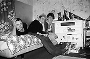 Ivor, Nikky and Lorp in bedroom in Hawthorne Road, UK, 1980s.